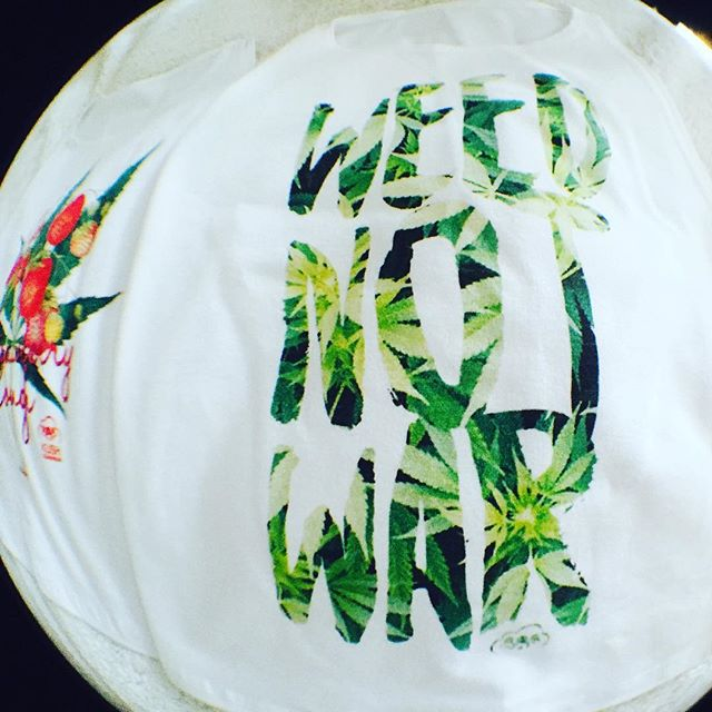 """Oh the things Cannabis could do for the world......🌍 Little upgrade to our """"weed not war top""""! Available in men's/unisex & women's sizes and a number of styles! 📬Link to our shop in my bio :)"""